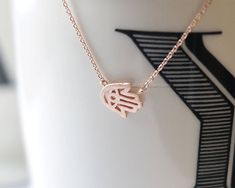 rose Gold Tiny Sideways Hamsa Necklacem    Hamsa on delicate rose gold Filled chain or rose gold plated chain. Very pretty, dainty and stylish.  Lovely
