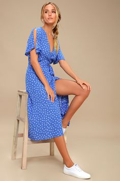 Add a breath of fresh air to your wardrobe with the Lulus Maretta Blue and White Floral Print Wrap Midi Dress! A plunging surplice bodice, and fluttering, split short sleeves are made from woven rayon in a cute blue and white floral print. Tying waist and wrap midi skirt. Free shipping and returns!