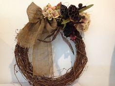 Harvest wreath with burlap bow.