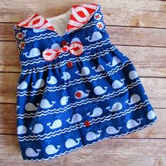 """This is the adorable little dress I made from the Seaside Sailor Dress Pattern during the recent Tie Dye Diva patterns sew along! I love how it turned out. So teeny tiny in 0-3 months size. The fabric I used is from the new True Blue collection by Ana Davis for Blend Fabrics and was … Continue reading """"Matching Fabric Print across a Button Placket"""""""