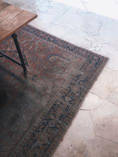 worn persian rug, cracked concrete floor brydiemack:  Details - Seminyak, Bali.