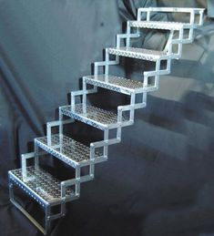 """Scissor Stairs - SO, maximum rise for these is 48""""/4', but, i'm thinking these could somehow be incorporated into a more traditional stair, this being the lower bit. The treads of the upper stair could have built-ins below for storage."""