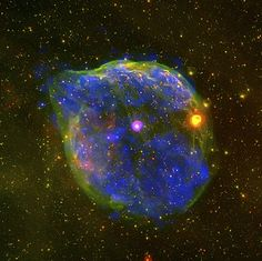 Wolf-Rayet bubble.    A giant bubble blown by the massive Wolf-Rayet star HD 50896, the pink  star in the centre of the image.  X-ray data from XMM-Newton's EPIC camera are shown in blue, while optical images were acquired using the Michigan Curtis Schmidt Telescope at Cerro Tololo Inter-American Observatory (CTIO) and presented in red (H-alpha) and green (OIII).  The bubble, known as S 308, is about 60 light-years across and is located 5000 light-years away in the constellation of Canis…