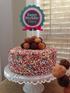 Cute donut hole topped sprinkle cake at a Favorite Things Birthday Party! See more ideas at CatchMyParty.com! #partyideas #favoritethings