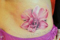 orchid tattoo by Mirek vel Stotker