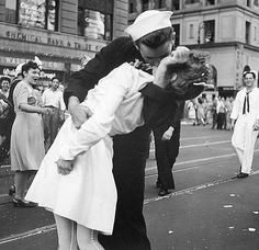 One of my favorite photos ever, probably because I'm a Navy brat.  The quintessential homecoming kiss.