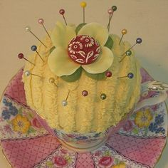 chenille pincushion in a teacup with saucer  not antique but such a nice idea