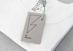 Logo and uncoated, unbleached tag for children's fashion brand The Fableists designed by Freytag Anderson featured on BPO.