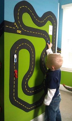 How cool is this race track on a bedroom wall?  It's magnetic too so toy cars stick to it!  Love this!