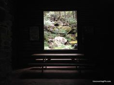 Looking out at Acriggs Falls from inside Bordner Cabin in Swatara State Park, Pennsylvania. - http://uncoveringpa.com/visiting-swatara-state-park