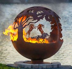 Wildfire Horse Themed Sphere Fire Pit Sphere. Sculptural fire bowls by Melissa Crisp features three horse scenes.