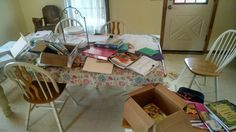 This is what my dining room table looked like last week.  It took me several days to get in gear for starting school this week!