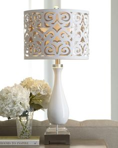 Glossy white #lamp is crowned with a laser-cut drum shade backed with silvery inner shade. Love