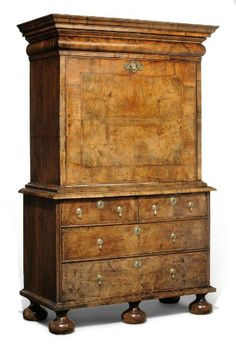 A QUEEN ANNE WALNUT AND FEATHER-BANDED ESCRITOIRE  EARLY 18TH CENTURY. With fall-front enclosing fourteen drawers around a central cupboard and open compartment below, above two short and two long drawers, on bun feet