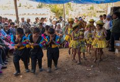 Children dancing at a dedication ceremony on September 21 for 2 complementary road projects in Curzani, Bolivia built by Mano a Mano.