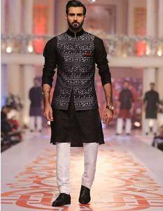 Latest black and white kurta pajama with waistcoat for grooms in Pakistan