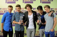 British boy band One Direction were the big winners at the MTV Video Music Awards, edging out Rihanna and taking home three prizes. (via Reuters; photo: Jordan Strauss / AP)