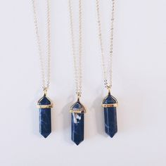Sodalite Crystal on an 18 inch gold chain. (Due to the genuine nature of these crystals, each one will vary slightly in color (still purple) & pattern. Each