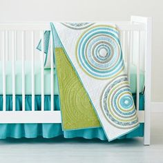 I like turquoise and lime green with white as a color scheme....???? Crate & Barrel: Baby Crib Bedding: Baby Crib Blue Comtemporary Appliqued Circle Crib Bedding in Crib Bedding