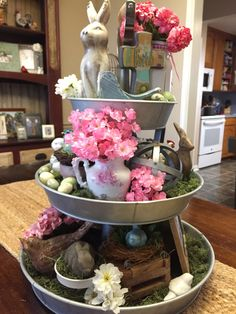 Wonderful Easter Decoration Ideas For Your Inspiration; Easter Table Decoration Ideas With Egg And Bunny; Egg And Bunny; Galvanized Tiered Tray, Galvanized Decor, Easter Table, Easter Decor, Easter Ideas, Easter Crafts, Seasonal Decor, Holiday Decor, Tiered Stand