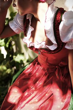 Dirndl like the light ruffled neckline of the blouse