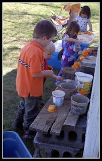 outdoor play kitchen... wood, bricks and empty tubs