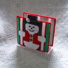 """Get ready for some hot cocoa and cinnamon toast with your new smiling snowman napkin holder covers."""" by Evie Plastic Canvas Coasters, Plastic Canvas Crafts, Plastic Canvas Patterns, Christmas Arts And Crafts, Christmas Signs, Metallic Yarn, Plastic Canvas Christmas, Plate Holder, Tissue Boxes"""