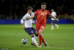Italy midfielderMarco Parolo - who was booked on the night - challengesDarko Velkoski