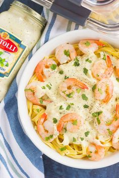 This Grilled Shrimp Alfredo Pasta is packed with tender noodles and grilled shrimp, all tossed in a creamy basil alfredo sauce. Simple to make and ready in less than 30 minutes, this easy meal will keep you going on busy weeknights! #PremiumPrep #ad