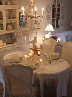 Love the centerpiece and the bird cage!      Whimsical Raindrop Cottage, my-place-of-recovery: ♥