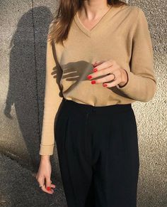 Camel sweater and black trousers.