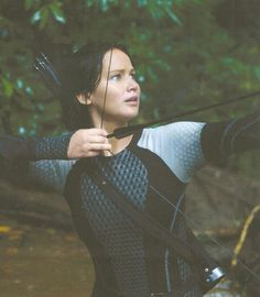 Jennifer Lawrence as Katniss Everdeen in Catching Fire