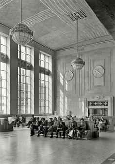 "June 12, 1935. ""Newark passenger station, Pennsylvania Railroad. Waiting room, sunlight and passengers. McKim, Mead & White, client."" Large format negative by Gottscho-Schleisner."