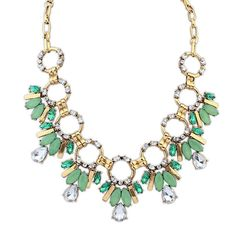 Rebecca Stunning Green and Clear Gem Necklace £12.00  This stunning necklace is popular not only eveningwear, but also office wear. The elegant splash of green adds life into even the dullest of suits. The necklace would work exceptionally well when matched with a bracelet and earrings, although it works perfectly as a stand-alone accessory for a subtle look.