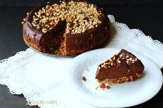 Slow Cooker Chocolate Cheesecake with Pretzel Crust and Nut Topping