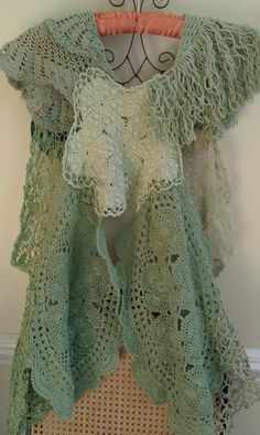 Back of seafoam green crochet doily vest