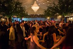 #InAnyEventNY custom built trees line the dance floor and function as poles for the edison bulb installation. #ShelterRockJewishCenter Photography by Nathan Smith of Ira Lippke Studios