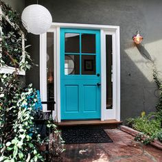 grey exterior. blue door. I love this! Maybe black shutters?