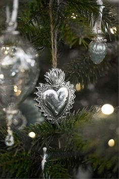 I hang my antique collection of ex votos on my Christmas Tree too