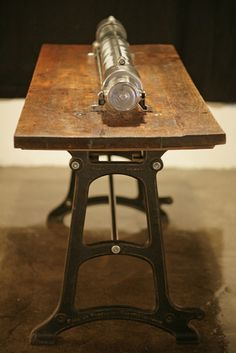 "Up-cycled table with industrial tube light. The base frame of the table is made from ""Forster Laundry machine factory Rumsch and Hammer, Forst (Lausitz/ Germany),1910."
