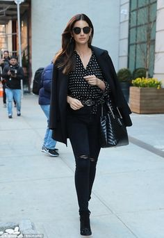 Got her 'wings' in 2010: Victoria's Secret Angel Lily Aldridge opted for head-to-toe black as she made her way out of her Manhattan hotel on Thursday morning