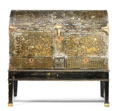 A Nanban lacquer coffer The chest Japanese, Momoyama period (1573-1615), the stand English, early 19th century    The chest 60cm x 100.5cm x 48.1cm (23¾in x 39½in x 19in), the stand 36cm x 104cm x 50cm (14 1/8in x 41in x 19¾in). (3).