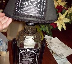 jack daniels lamp, home decor, lighting, repurposing upcycling, This is just before I filled the bottle with whiskey colored glass stones Jack Daniels Lamp, Jack Daniels Bottle, Glass Jars, Candle Jars, Candles, Cloud Lights, Sign Lighting, Cool Lamps, Light Crafts