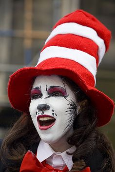 "Cat in the Hat make-up. I'm gonna be honest, I don't love the red eyeshadow, but I do like the furry bit peeking from her cheek. (If you love Seussical, check out my novel ""Bit Players, Bird Girls and Fake Break-Ups"".)"