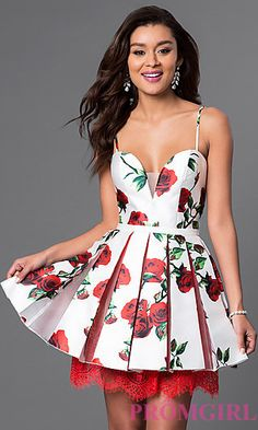 Short, mesh insert, v-neck, spaghetti strap floral print homecoming dress with box pleated skirt and lace underskirt.