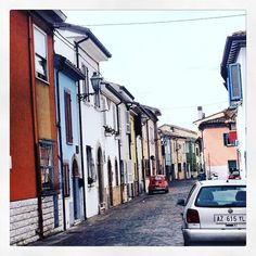 """A foto from the 1970s ? Nope! This was taken this morning in the picturesque """"Borgo San Giorgio"""" one if the most characteristic areas of #Rimini. A old fishing village that was abandoned in the 60s only to become one of the most chic areas of the city. If you visit in September during the Festival celebrating the area homeowners will welcome you into their homes for a tour! To get here you have to cross the """"Ponte di Tiberio"""" an ancient Roman bridge started by Emperor Augustus and finished…"""