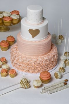 Peach Rosette Wedding Cake with a Gold Heart