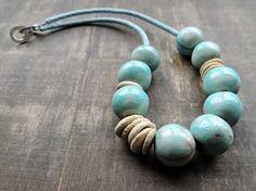 https://www.etsy.com/nl/listing/182833742/soft-blue-handmade-ceramic-beads-mixed?ref=shop_home_active_1