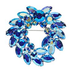 This is a very fine Sherman #vintage #brooch dating to the 1960s.  The brooch has a pretty wreath shape and is made from multi-faceted round and marquise cut 'aurora borealis' Austrian crystal.  The predominant colour is blue but the brooch picks up pinks, purples and green. Beautiful piece of #vintagejewellery. Signed Sherman. Beautiful on a jacket or gown and could be worn on the lapel, shoulder or waist. €149 Available from www.luluandbelle.com