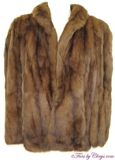 Vintage Brown Ermine Cape BE808; $200; Very Good Condition; Size range: S-M-L. This is a lovely genuine brown ermine fur cape. It has a Gimbel Brothers label and features a small shawl collar and slits to put your arms through, or you may leave your arms to your side under the cape. It has two exterior pockets and interior shoulder straps so you may drape the cape over your shoulders for extra elegance.  This glamorous brown ermine cape will make you nostalgic for the golden days of…